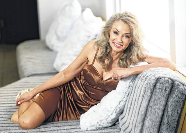 Model Kathy Jacobs poses for a portrait at her home in Calabasas, Calif. on Friday. Jacobs made her Sports Illustrated swimsuit issue debut at age 56.