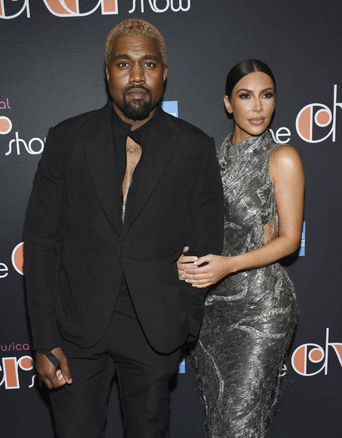"FILE - Kanye West, left, and his wife Kim Kardashian West attend ""The Cher Show"" Broadway musical opening night at the Neil Simon Theatre in New York on Dec. 3, 2018. Kardashian West is asking the public to show compassion and empathy to husband Kanye West, who she says is bipolar and caused a stir this week after fulminating in a series of social media posts. The reality TV star posted a lengthy message Wednesday on her Instagram Live feed, explaining that life has been complicated for her family and West, who ranted against historical figure Harriet Tubman and discussed abortion on Sunday while he declared himself a presidential candidate. (Photo by Evan Agostini/Invision/AP, File)"