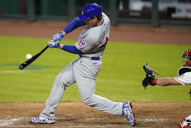 Chicago Cubs' Anthony Rizzo hits a home run during the sixth inning against the Cincinnati Reds in a baseball game in Cincinnati on Monday, July 27, 2020. (AP Photo/Bryan Woolston)