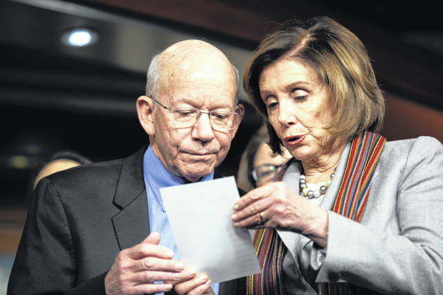 House Speaker Nancy Pelosi of Calif., right, shows a note to Rep. Peter DeFazio, D-Ore., during a news conference, Wednesday, Jan. 29, 2020, on Capitol Hill in Washington.