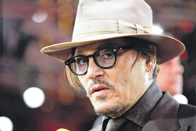 FILE - In this Friday, Feb. 21, 2020 file photo, actor Johnny Depp arrives for the screening of the film Minamata during the 70th International Film Festival Berlin, Berlinale in Berlin, Germany. A British judge on Thursday July 2, 2020, rejected an attempt by tabloid newspaper The Sun to quash a libel suit from Johnny Depp over an article claiming he abused ex-wife Amber Heard.