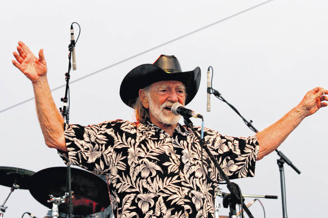 FILE - In this July 4, 2006, file photo, Willie Nelson addresses fans attending his Fourth of July Picnic in Ft. Worth, Texas. Willie Nelson's annual Fourth of July Picnic is going ahead this year, but to reduce concerns about the coronavirus the event will be virtual. Fans can tune in to the nearly 50-year-old music bash Saturday via livestream.