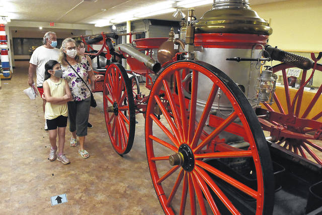 Chris and Tonia Groh, of Lima, tour the Allen County Museum with their grandchildren, Emily and Lydia Warner.