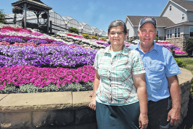 Mary and Adin Horst, owners of Amherst Greenhouse, in Harrod.