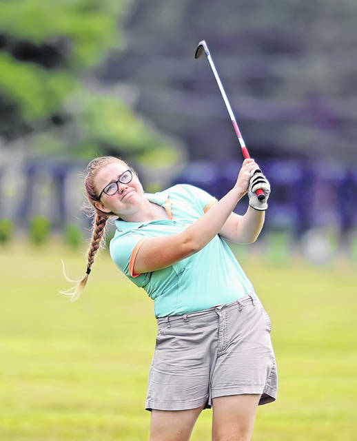 Kalida's Grace Miller watches her second shot on the 15th hole during Thursday's two-player scramble at Bluffton Golf Club.