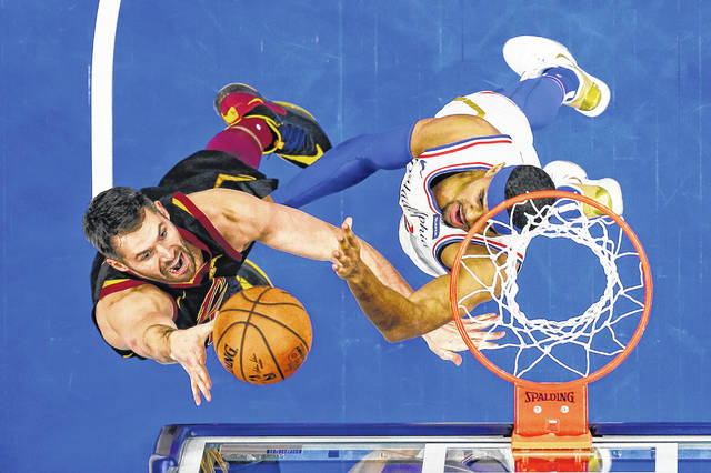 Cleveland Cavaliers' fans still talk about the Cavs' NBA title in 2016 as if it were yesterday. They voted the Cavs the region's favorite pro basketball team. Above, Cleveland's Kevin Love, left, powers in a basket underneath the net.