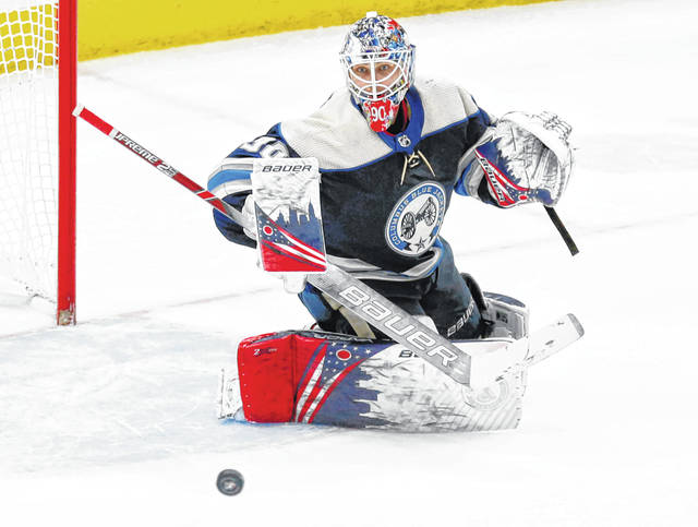 The Columbus Blue Jackets began in 2010 as an expansion team in the National Hockey League. During the next 10 years they've won the hearts of their fans, who voted them the region's favorite pro hockey team. Above, goalie Elvis Merzlikins makes a stop.