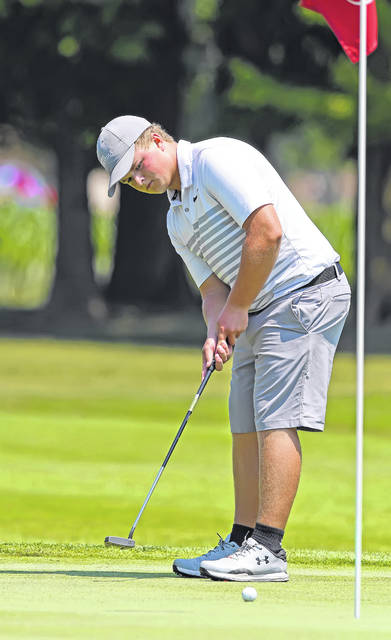 Elida's Carson Harmon putts on the 17th hole during Thursday's Delphos Country Club Open.