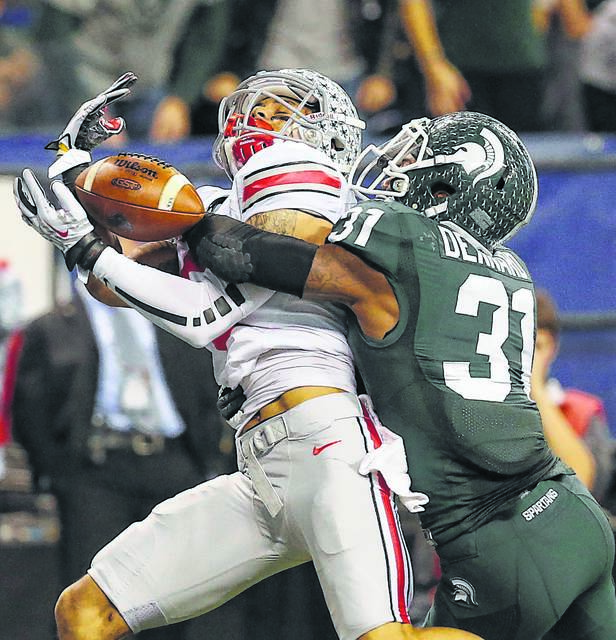 Michigan State's Darqueze Dennard (31) breaks up a touchdown pass intended for Ohio State's Devin Smith (9) in the second half of the 2013 Big Ten Championship game. DON SPECK/The Lima News