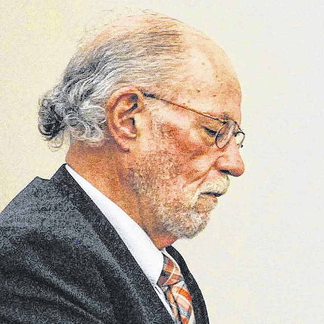 """Attorney Jerome """"Jerry"""" Doute appears with a client in an Allen County courtroom in March 2018."""