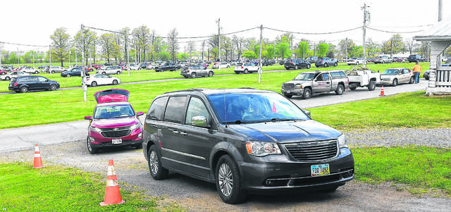Over 500 vehicles wait in line to enter the Allen County Fairgrounds during a major food distribution in May.