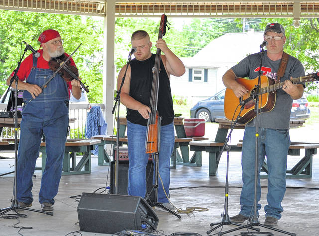 Members of 7 Mile Bluegrass performed Saturday afternoon at the Rotary Pavilion in Stadium Park in Delphos.