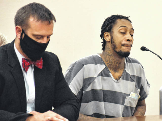 Raylon Hardy, pictured with his attorney, Carroll Creighton, reportedly shot and injured Michael Gooding and Leroy Smith as they sat on the porch of a Lima residence Nov. 26. Hardy was sentenced Thursday to 24 years in prison.