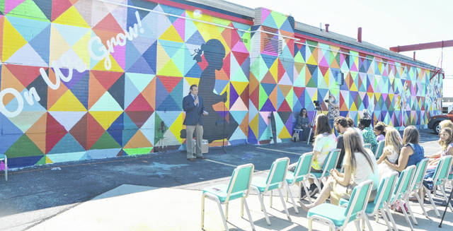 The colorful backdrop painted onto the side of I CAN Ministries was created through a mural project partially initiated by Hayes.
