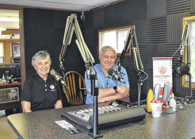 Holy Family Radio co-founder Mary Ann Deitering, left, and managing director and host Deacon Jeff Compton sit in the current station studio.