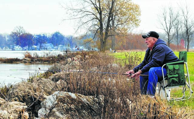 Bob Alberding, of Indian Lake, fishes along the shore for saugeye.