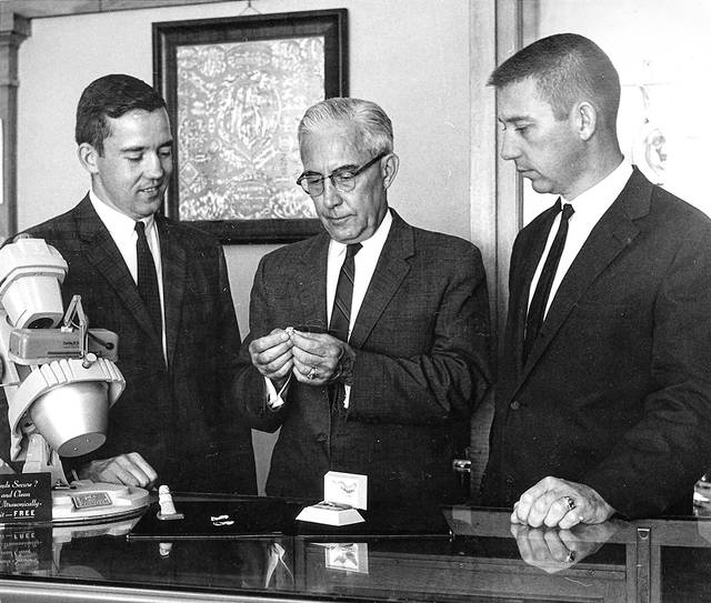 Ken, Warren and Bob Basinger are at the jewelry counter in this undated photo.
