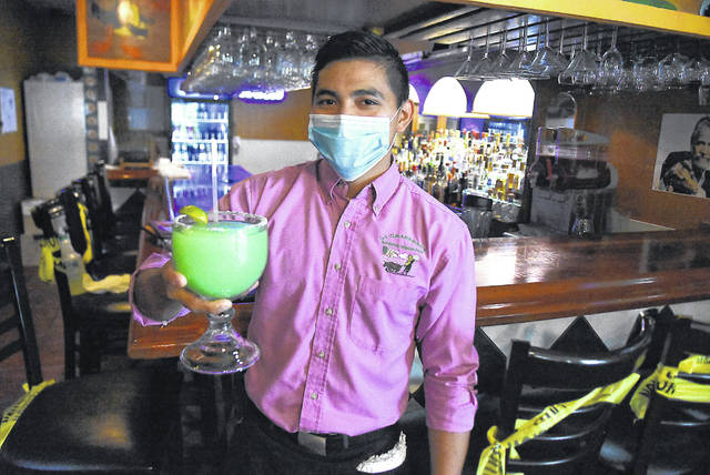 Diego Mateo holds a margarita at La Charreada on Cable Road in Lima.