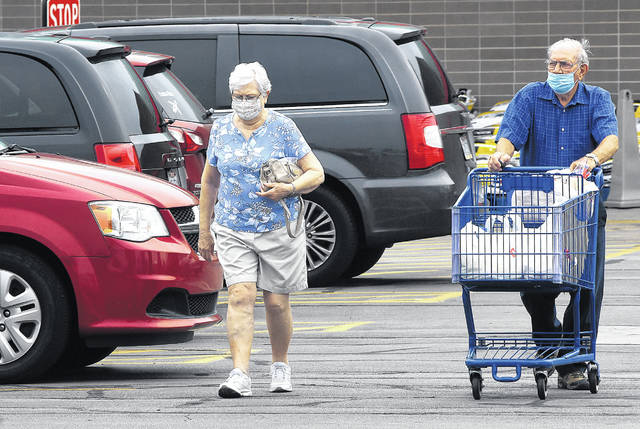 Area residents wear masks while shopping at the Meijer store on Elida Road in Lima.