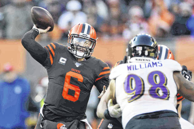 Cleveland Browns quarterback Baker Mayfield (6) throws a pass against the Baltimore Ravens during a game last season. Mayfield could be among the Browns players making the biggest adjustments with a new coaching staff this season.
