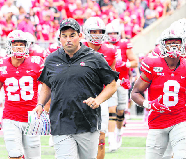 Coach Ryan Day runs out onto the field at the start of a past game.