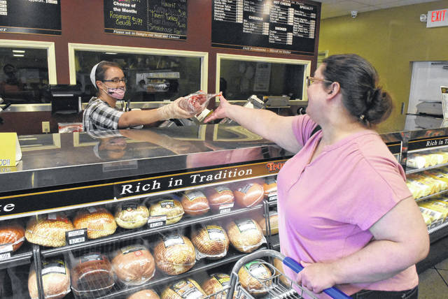 Audrey Eby gives a deli order to Rowan Cattell of Cairo at the Old Thyme Pantry in Elida.