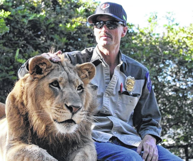 """John Reinke is pictured with a lion at the G.W. Zoo. Reinke, a 1984 graduate of Sidney High School, was a primary source in the hit Netflix documentary """"Tiger King,"""" which showcased an inside look into exotic animal parks and the rivalry between Joe Exotic and Carole Baskin, culminating in a failed murder-for-hire plot."""