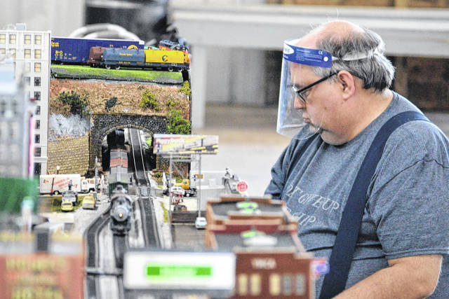 Steve Glass keeps a close eye on the model train as it passes under a bridge. Several hundred people attended the Railroad Heritage show and swap meet at the Van Wert County Fairgrounds over the weekend. The event is a fundraiser for the Van Wert County Historical Society.