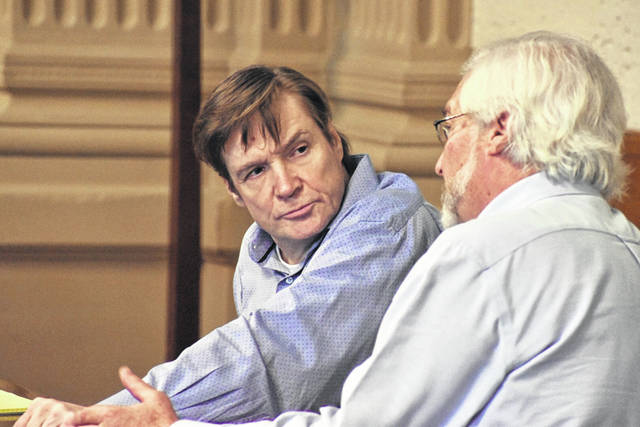 Kenneth Richey, left, consults with his attorney, Greg Meyers, during Tuesday's trial at the Putnam County Courthouse in Ottawa.