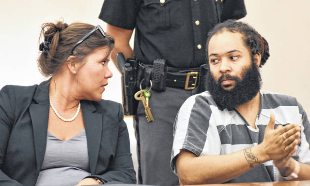 Anthony Ridley, 34, of Lima, is scheduled to stand trial Sept. 14 for allegedly robbing and assaulting a man with a handgun in January. Ridley's bond was lowered from $500,000 to $75,000 Wednesday. If he posts bond, Ridley will be required to wear a GPS ankle bracelet and will be under a strict curfew. He is pictured with his Columbus attorney, Breezy Warner.