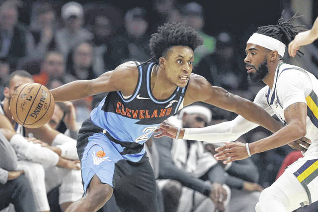 Cleveland Cavaliers guard Collin Sexton, left, drives past Mike Conley of the Utah Jazz during an NBA game earlier this season. Sexton has made the Cavaliers selecting him as their first-round draft pick in 2018 look good.