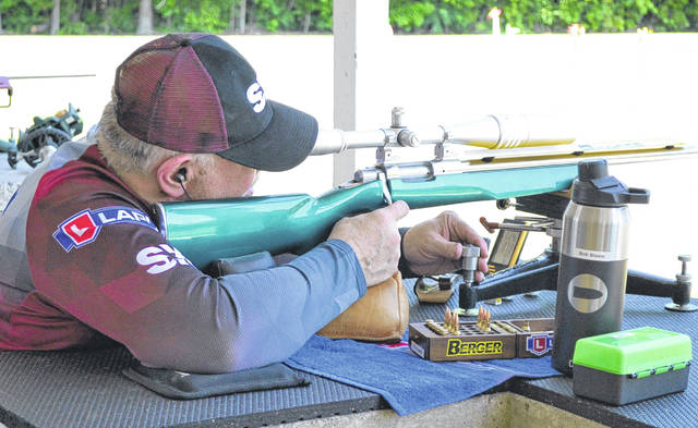 Bob Blaine takes aim at the target while competing at the Black Swamp Rifle and Pistol Club Sunday near Delphos.