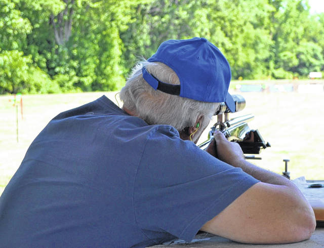 Chuck Entsminger draws a bead on his target at a shooting competition near Delphos on Sunday.
