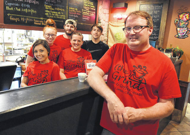Jack Hilvers, co-owner of (the) Grind Cafe & Coffeehouse, with his staff.