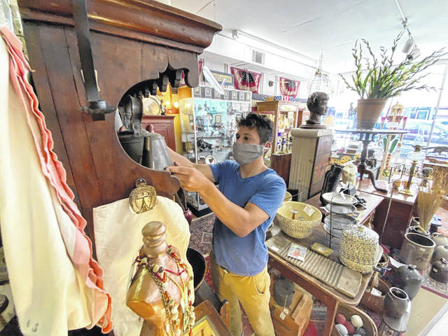 Ethan Skaggs works on a display at the Auglaize Antique Mall in Wapakoneta.