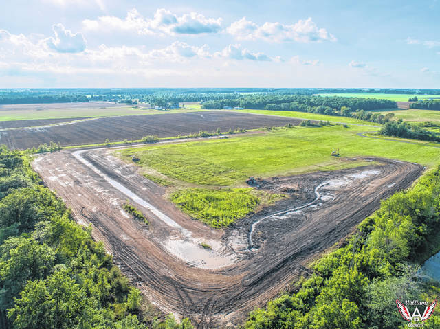 An overhead view shows the new wetland near the Kalida Fish & Game Club.