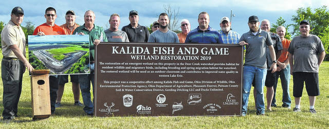 An effort to create a 2.5-acre wetland north of Kalida is complete. Representatives of eight different entities gathered Wednesday to dedicate signage for the wetland.