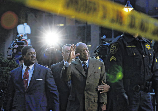 FILE - In this Feb. 2, 2016, file photo, Bill Cosby waves to cheering fans as he leaves after a court appearance in Norristown, Pa. Cosby was convicted of sexual assault in 2018. He is serving up to 10 years in prison. Now in the midst of another historic reckoning, this time addressing the treatment of African Americans and other people of color by police and the criminal justice system, the 82-year-old Cosby has won the right to an appeal.