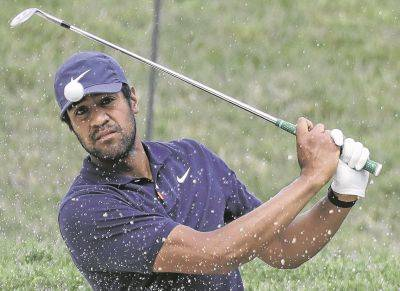 Tony Finau hits from a bunker toward the 14th green during Thursday's first round of the Memorial tournament in Dublin.