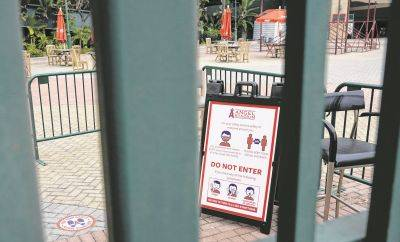 Signs stationed Wednesday inside the gate require those entering Angels Stadium in Anaheim, Calif., to wear masks and practice social distancing amid the coronavirus pandemic.