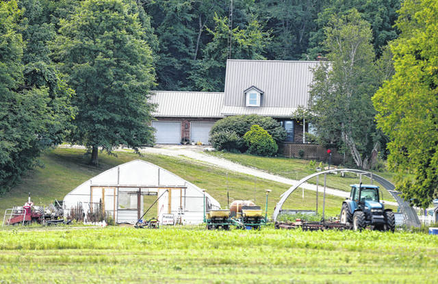 Property belonging to Ohio House Speaker Larry Householder is seen Tuesday in rural Glenford, Ohio. Householder was taken into custody by federal authorities at the property Tuesday morning as part of a $60 million bribery investigation.