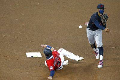 Cleveland's Francisco Lindor throws to first to complete a double play after forcing out Minnesota's Marwin Gonzalez at second base during Friday night's game in Minneapolis. (AP phone)