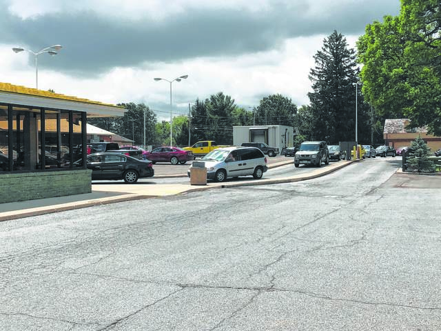 Cars wait in line at the drive-thru at Kewpee West.