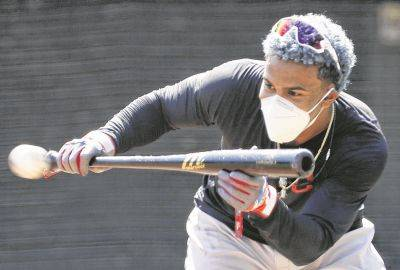 The Indians' Francisco Lindor works on his bunting skills Monday during practice at Progressive Field in Cleveland.