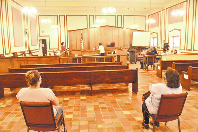 Two spectators awaited the start of a jury trial Tuesday in an Allen County courtroom. The first trial of the COVID-19 era was held in a recently renovated fourth-floor courtroom in the county courthouse.
