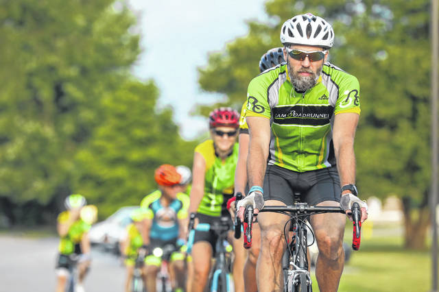David Pauff of Lima starts his early morning ride with Team Roadrunners at Rally Point River Ride held at the Allen County Board of Developmental Disabilities on Saturday morning.