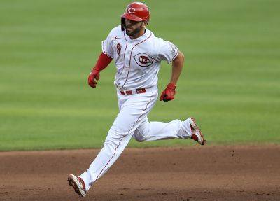 The Reds' Mike Moustakas runs the bases after hitting a two-run home run during Wednesday night's game against the Chicago Cubs in Cincinnati. (AP photo)
