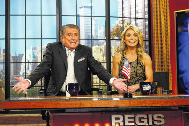 "Regis Philbin and Kelly Ripa during Regis' farewell episode of ""Live! with Regis and Kelly."""