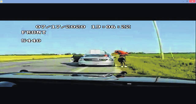In this screen grab from a law enforcement video, Raepheal A. Dell, 22, reacts to an officer pulling up.