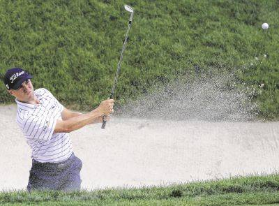 Justin Thomas hits from the 16th bunker during Saturday's third round of the Workday Charity Open in Dublin, Ohio.